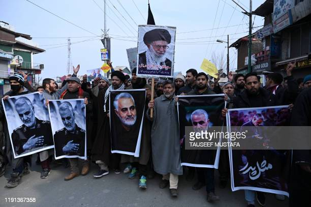 Protesters shout slogans against the United States and Israel as they hold posters with the image of top Iranian commander Qasem Soleimani who was...