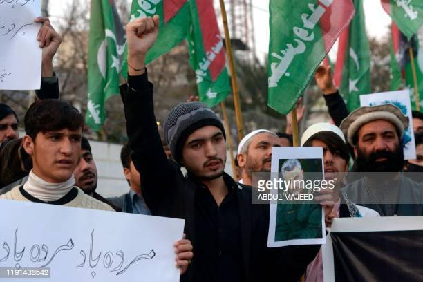 Protesters shout slogans against the United States during a demonstration following a US airstrike that killed top Iranian commander Qasem Soleimani...