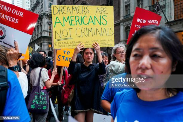 Protesters shout slogans against US President Donald Trump during a demonstration in support of the Deferred Action for Childhood Arrivals also known...