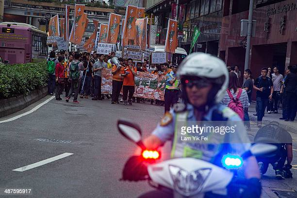 Protesters shout slogans and hold banners during a May Day demonstration on May 1 2014 in Macau China Hundreds of protesters attended a march against...