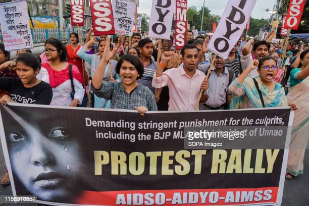 Protesters shout slogans as they demand for justice for a UNNAO rape case victim against a Bharatiya Janata Party legislator during the protest In...