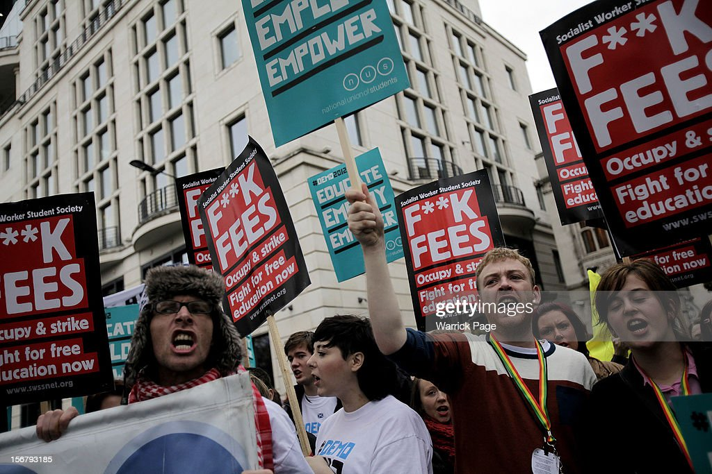 Protesters shout slogans as they gather to demonstrate against education cuts, tuition increases and austerity on November 21, 2012 in London, England. The demonstration march was organised by the National Union of Students and is the first national student protest since a series of violent protests against tuition fees two years ago.