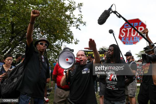 Protesters shout slogans as they march down streets in Chicago Thursday to draw attention to the citys gun violence briefly shutting down a major...