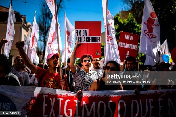 Protesters shout slogans as they march during a May Day rally in Lisbon on May 1 2019