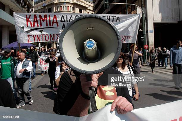 Protesters shout slogans as they march towards Parliament during a labour strike on April 9 2014 in Athens Greece Labour unions across Greece are...