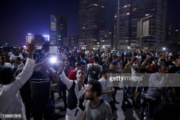 Protesters shout slogans as they take part in a protest calling for the removal of President Abdel Fattah al-Sisi, along the October 6 bridge linking...