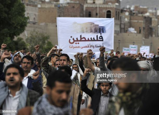Protesters shout slogans at Bab alYaman street during a protest against United States' plans to relocate the US Embassy from Tel Aviv to Jerusalem...