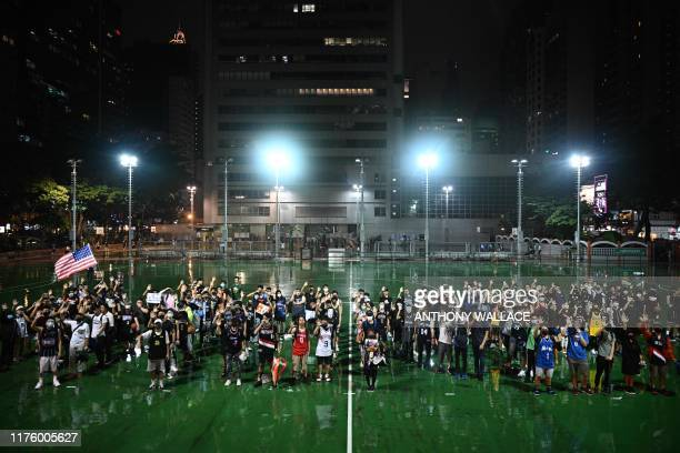 Protesters shout slogans at the Southorn Playground in Hong Kong on October 15 during a rally in support of NBA basketball Rockets general manager...