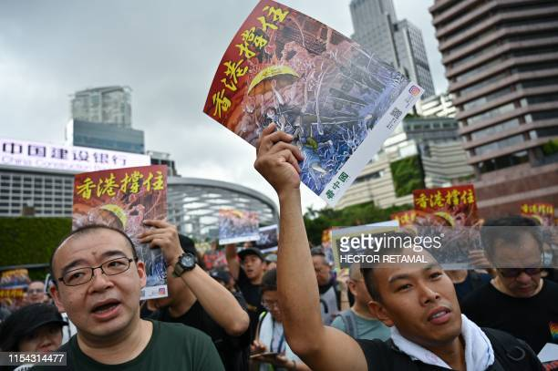 Protesters shout slogans before a march to the West Kowloon railway station where highspeed trains depart for the Chinese mainland during a...