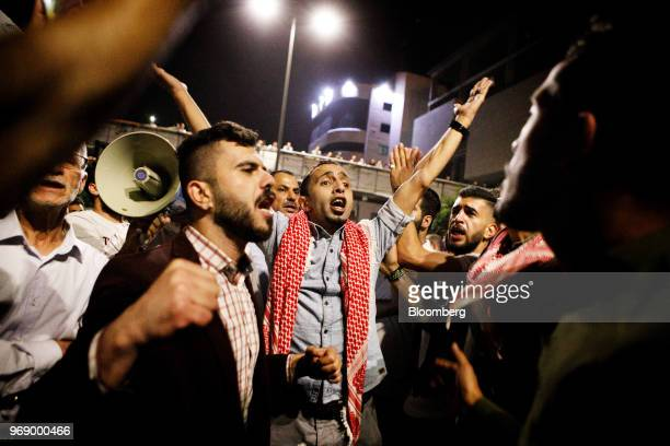 Protesters shout slogans during a demonstration against a draft income tax law near the prime minister's office in Amman Jordan on Wednesday June 6...