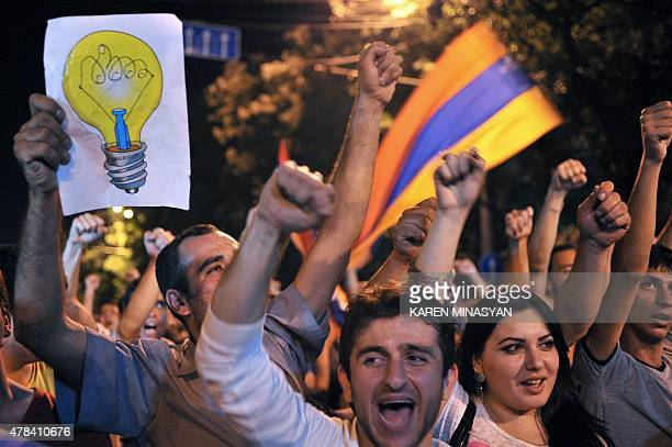 Protesters shout slogans during a demonstration against an increase of electricity prices in Yerevan early on June 25 2015 Over 9000 demonstrators...