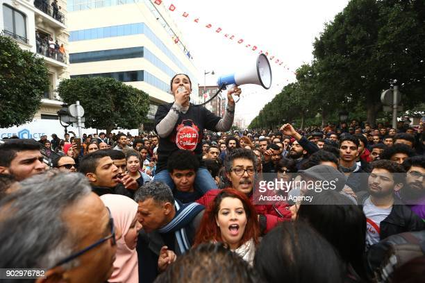 Protesters shout slogans during a demonstration against price hikes on Avenue Habib Bourguiba in front of Municipal Theatre of Tunis Tunisia on...