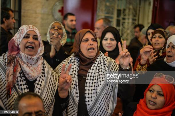 Protesters shout slogans during a demonstration demanding the release of the Palestinians held in Israeli prisons in front of the International Red...