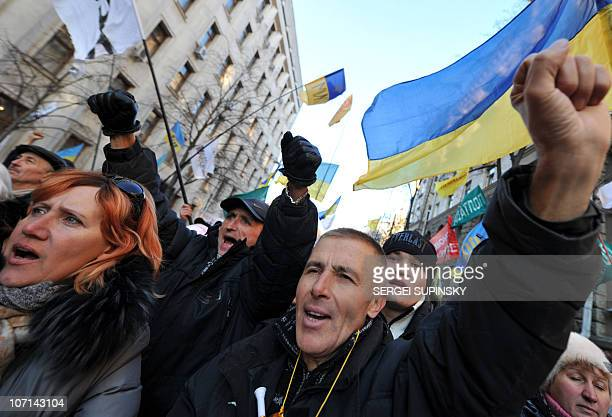 Protesters shout slogans during a mass rally in front of President Viktor Yanukovych's office in Kiev on November 25 2010 Some 4000 people...