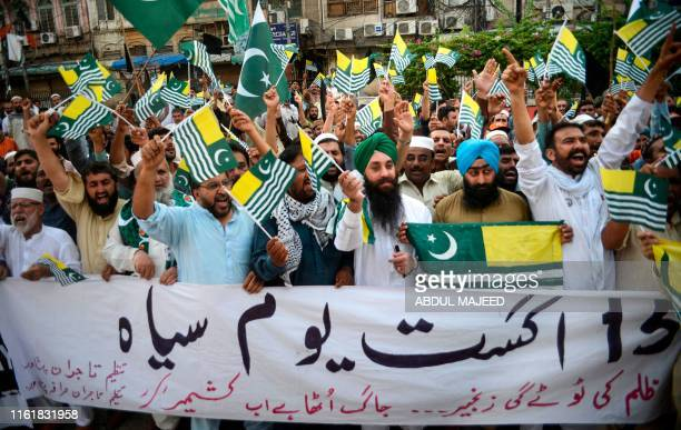 Protesters shout slogans during a protest against India in Peshawar on August 15 as the country observes 'Black Day' on India's Independence Day over...