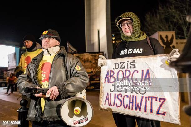 Protesters shout slogans during an antiabortion demonstration on January 10 2018 outside the Parliament in Warsaw The placard reads 'Today abortion...