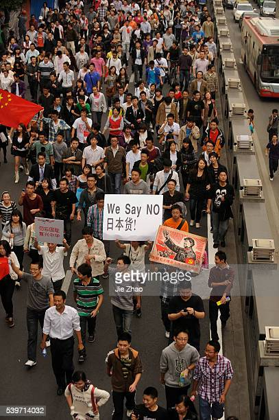 Protesters shout slogans during an antiJapan protest over disputed islands called Diaoyu in China in Chengdu Sichuan province October 16 2010 VCP