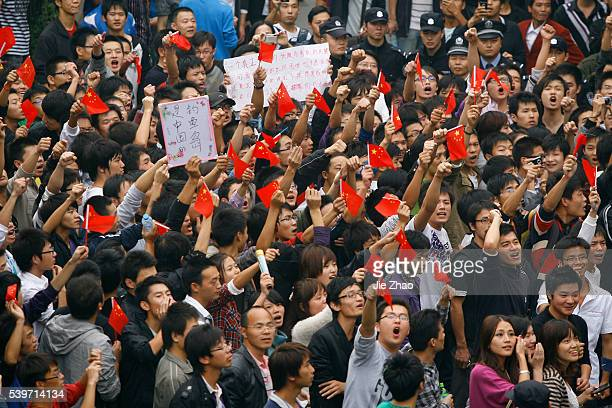 Protesters shout slogans during an antiJapan protest over disputed islands called Diaoyu in China in Wuhan Hubei province October 18 2010 VCP
