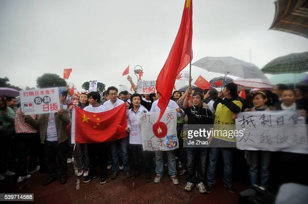 Protesters shout slogans during an antiJapan protest over disputed islands called Diaoyu in China in Chongqing municipality October 26 2010 VCP