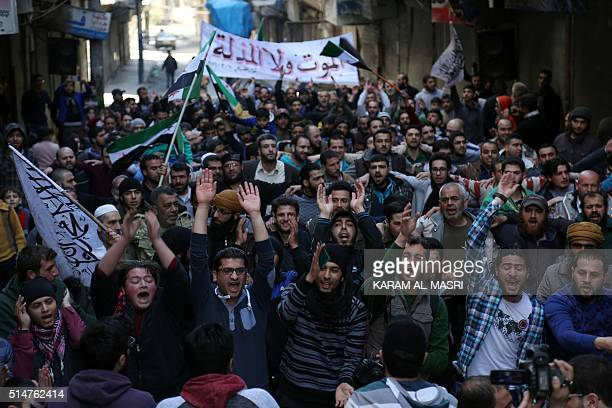 Protesters shout slogans during an antiregime demonstration in the rebelcontrolled Sukkari neighborhood of Syria's northern city of Aleppo on March...