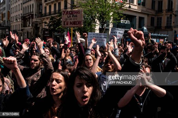 Protesters shout slogans during the annual May Day workers' rally in Lyon eastcentral France on May 1 2017 / AFP PHOTO / JEFF PACHOUD