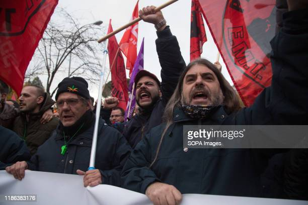 Protesters shout slogans during the demonstration. EMT workers protest supported by Metro and taxi workers. The bus drivers of the public urban bus...
