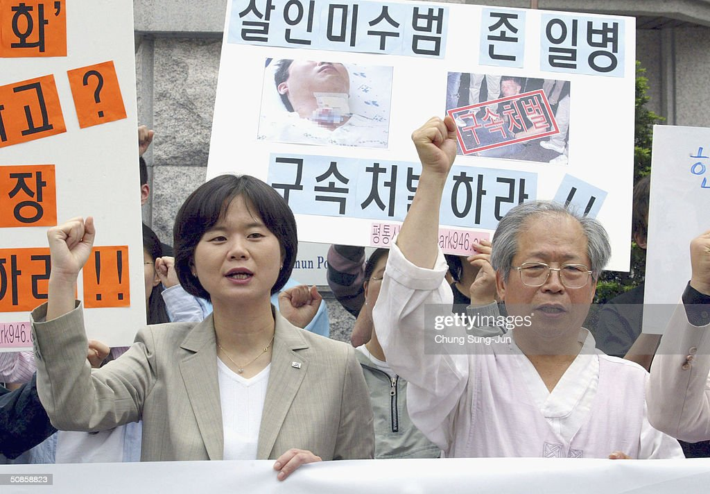 Protesters shout slogans in front of police station as John Humphreys, from the United States Forces Korea (USFK) appears at the police station on May 20 2004 in Seoul South Korea. Humpreys and four U.S. soldiers and one Korean soldier were arrested on May 15, following an attack on a 27-year-old civilian who had tried to stop the soldiers from making a disturbance in the area, the unidentified victim underwent surgery on his neck at a nearby hospital and remains in a non-critical condition.