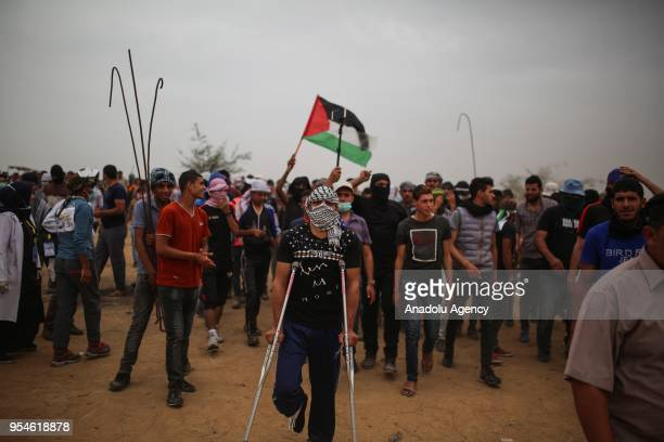 Protesters shout slogans in response of Israeli soldiers' intervention during a protest in support of Great March of Return near GazaIsrael border in...