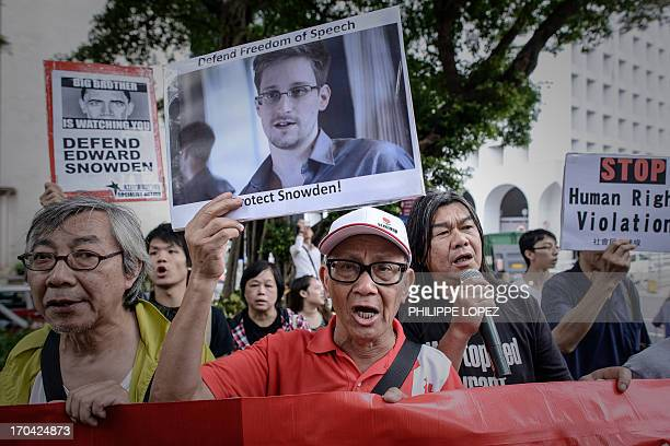 Protesters shout slogans in support of former US spy Edward Snowden as they march to the US consulate in Hong Kong on June 13 2013 Snowden broke his...