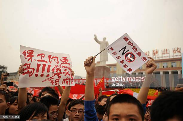 Protesters shout slogans near a statue of the late Chinese leader Mao Zedong during an antiJapan protest over disputed islands called Diaoyu in China...