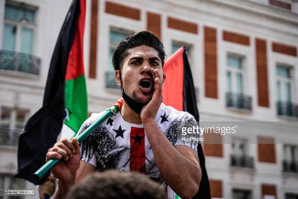 Protesters shout songs of support to the Palestinian people and against Israel at the demonstration in Madrid, Spain, on May 15 on the occasion of...