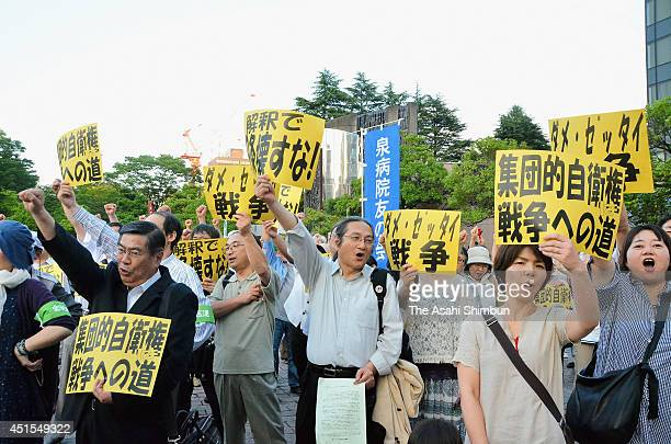 Protesters shout their opposition to the Abe Cabinet's move to allow Japan to exercise the right to collective selfdefense on July 1 2014 in Sendai...