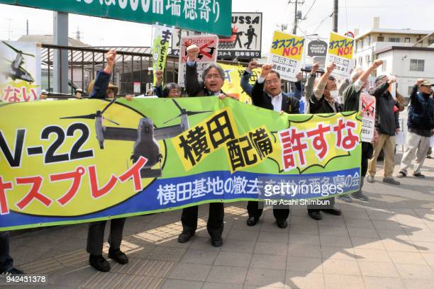 Protesters shout their slogans outside the Yokota Air Base as CV22 Ospreys are deployed on April 5 2018 in Fussa Tokyo Japan The transport aircraft...