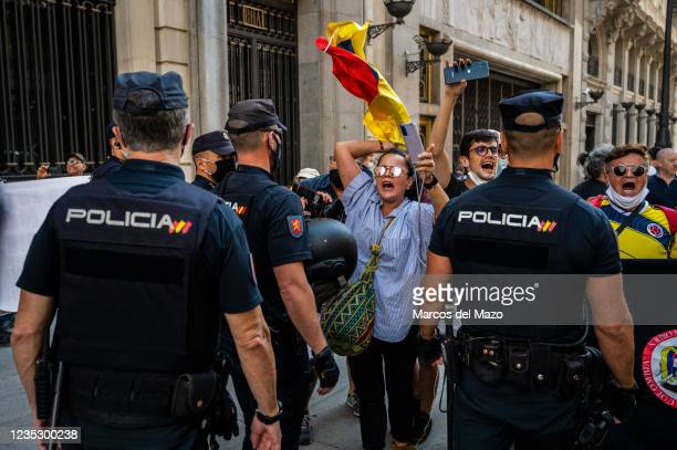 Protesters shouting slogans against the President of Colombia as police officers are blocking a demonstration against the visit to Madrid Book Fair...