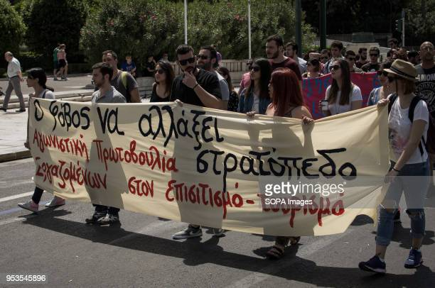 Protesters shouting slogans and holding banner at the demonstration On May 1st the workers day is celebrated It is in fact the established...