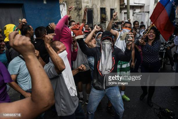 Protesters shouting slogans during a protest against Nicolas Maduro 27 Military officers of the National Guard were arrested after revolting in the...