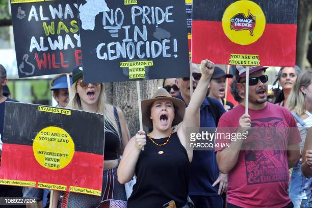 """Protesters shouts slogans as they march through the streets of Sydney in an """"Invasion Day"""" rally on Australia Day on January 26, 2019. - Thousands of..."""