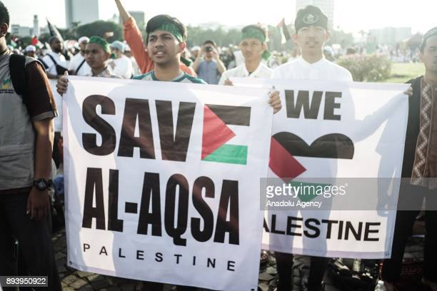 Protesters show a banner reading 'Support AlAqsa and Palestine' in the demonstration to support Palestine at National Monument in Jakarta Indonesia...