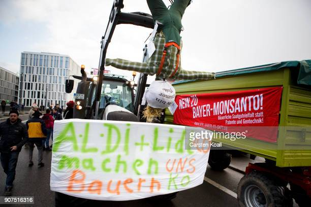 Protesters show a banner with the slogan 'AldiLidl knock us out' attached to a tactor during a march to demonstrate against the agroindustry on...