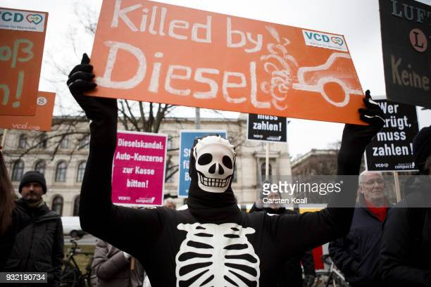 Protesters show banners during a bicycles protest against the ongoing diesel affair in front of the Transport Ministry on the day new Transport...