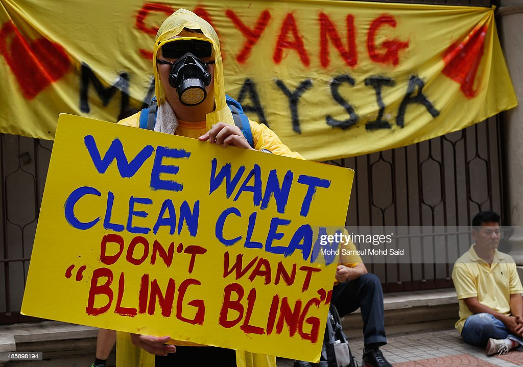 Protesters show the placard message during a Bersih (Clean) rally as protestors call for the resignation of Prime Minister Najib Razak on August 30, 2015 in Kuala Lumpur, Malaysia. Prime Minister Najib Razak has become embroiled in a scandal involving state fund debts and allegations of deposits totaling 2.6 billion ringgit paid to his bank account. Thousand of people gathered to demand his resignation and a new general election.