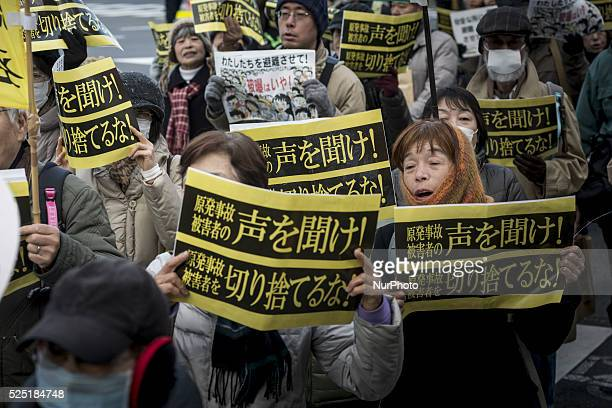 protesters show the sign that says listen to the voices of victims during the demo March 2 2016 in Tokyo organized by quotHidanrenquot the umbrella...