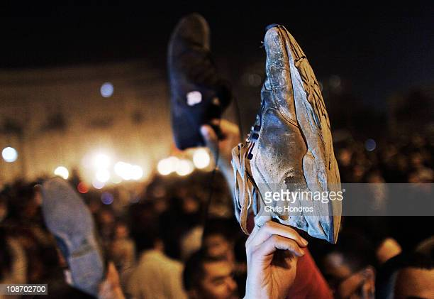Protesters show the soles of their shoes a grave insult in Arab Muslim countries as a reaction after Egyptian president Hosni Mabarak gave a speech...