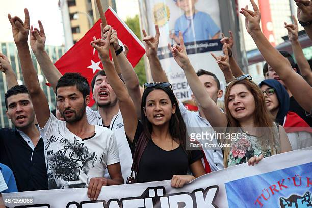 Protesters show the symbol of Turkish nationalist 'wolf' demonstrators gathered in Kzlay Square in Ankara to protested against terrorist attacks and...