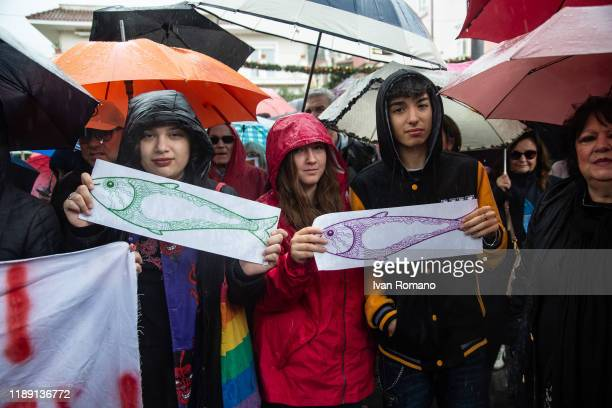 Protesters show the symbols of the sardine movement that began after demonstrations of Bologna and Modena during the visit of Lega leader Matteo...