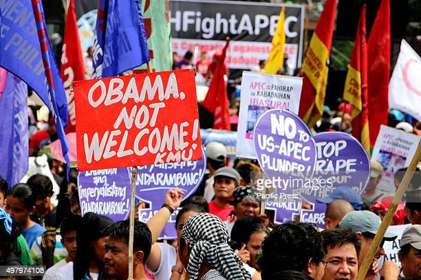 Protesters showing the message that Pres Obama is not welcome during their protest march in Buendia Avenue in Pasay City the militant group trying to...