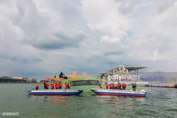 Protesters shows banners against the Italian government's decision to block ports to a German NGO ship with 629 migrants on board on June 13 2018 in...
