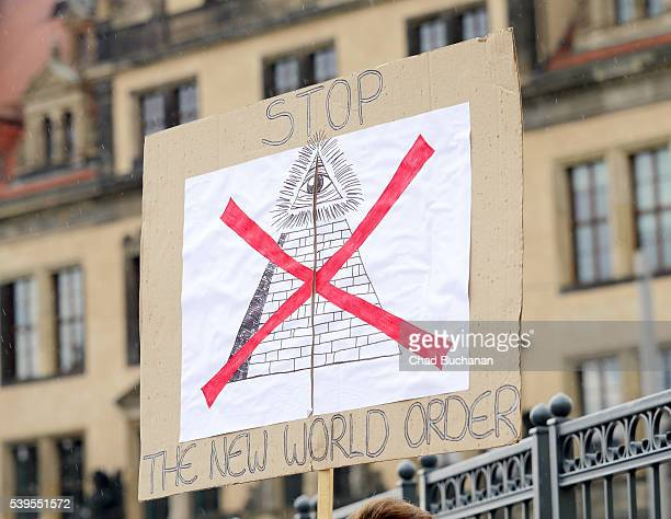 A protester's sign reads 'Stop The New World Order' near the venue of the 2016 Bilderberg Group conference on June 12 2016 in Dresden Germany Dresden...