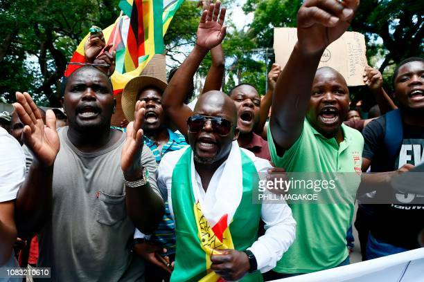 Protesters sing during a demonstration of Zimbabwean citizens outside the Zimbabwean Embassy in Pretoria on January 16 following the announcement of...