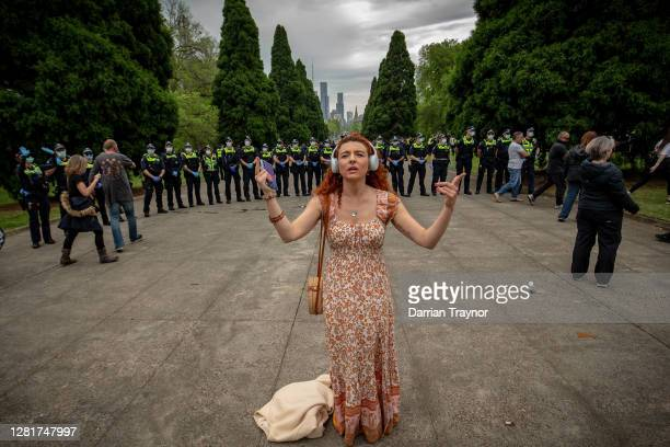A protesters sings a song on October 23 2020 in Melbourne Australia Protesters are calling on the end to lockdown restrictions in Victoria following...